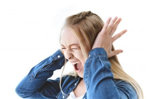 Autistic teen throwing a tantrum.