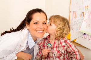 Autism Recovery: Child giving appreciative kiss to his health care worker.
