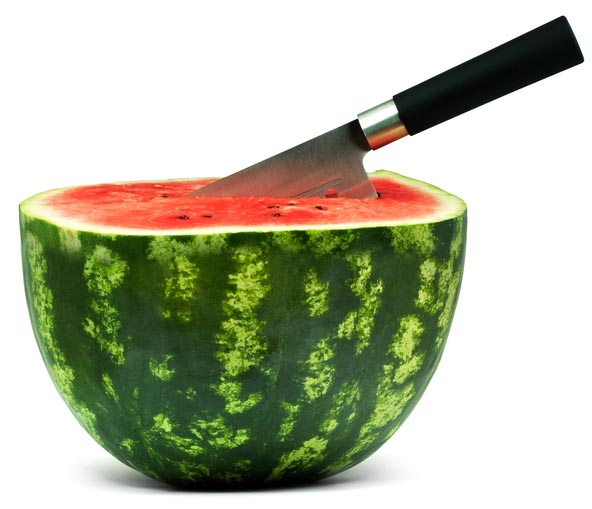 Watermelon with a knife in it.